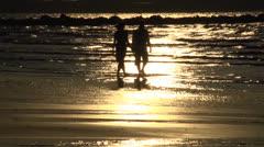 Beachwalk at sunset Stock Footage