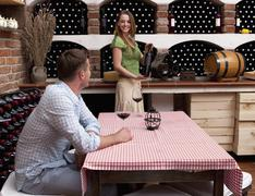 Croatia, Zadar, Young couple in wine cellar - stock photo