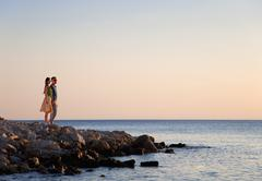 Croatia, Zadar, Young couple looking at sea - stock photo