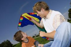 Father and son (4-7) with kite, close-up Stock Photos