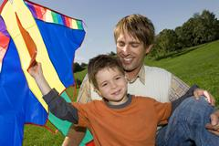 Father and son, boy holding kite Kuvituskuvat