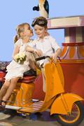 Germany, Landshut, girl kissing boy (4-5), sitting in carousel Stock Photos