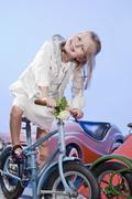 Germany, Landshut , little girl (4-5) riding carousel bike, smiling Stock Photos