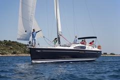 Croatia, Zadar, Friends relaxing on sailboat Stock Photos