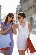 Croatia, Zagreb, Young women with shopping bags, smiling Stock Photos