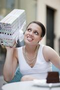 Croatia, Zagreb, Young woman with present - stock photo