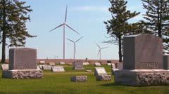 Giant windmills in the distance generate power behind farms in the American - stock footage