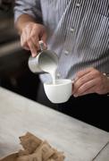 Croatia, Zagreb, Barkeeper making coffee in cafe Stock Photos