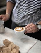 Croatia, Zagreb, Barkeeper making coffee in cafe - stock photo