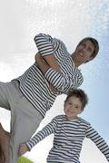 father and son (4-7), low angle view - stock photo