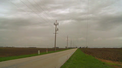 A lonely road across the flatlands in the midwest of the U/.S. Stock Footage