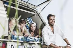 Germany, Cologne, Man and women in bus, smiling Stock Photos