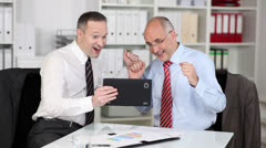 Exultant businessmen find the solution - stock footage
