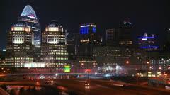 An establishing shot of Cincinnati Ohio at night with freeways foreground. Stock Footage