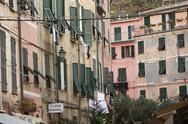 Stock Photo of Italy, Liguria, Vernazza, Houses with open shutters