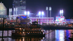 Light reflects off the Ohio River with the city of Cincinnati Ohio background as Stock Footage