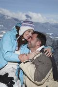Germany, Bavaria, Couple in winter clothes, embracing Stock Photos