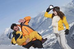 Germany, Bavaria, Family having snowball fight Kuvituskuvat