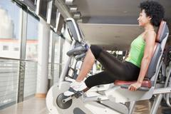 Stock Photo of Germany, Bavaria, Woman exercising in gym, portrait