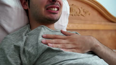 Chest Pain Young Man In Bed Stock Footage