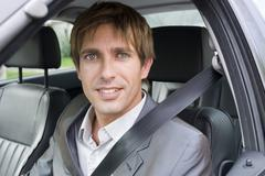 businessman sitting in car, close-up, portrait - stock photo