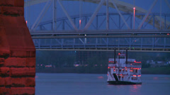 A riverboat passes under the bridges of Cincinnati on the Ohio River. Stock Footage