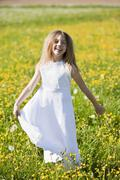 Germany, Bavaria, Girl (8-9) in meadow, smiling, portrait Stock Photos