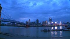 Pan across the Ohio River as night falls on Cincinnati. Stock Footage