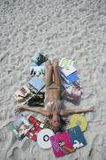 Stock Photo of Germany, Bavaria, Young woman relaxing in sand
