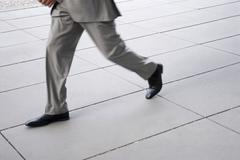 businessman running, low section, (blurred motion) - stock photo