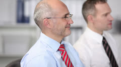 Smiling businessman in a meeting Stock Footage