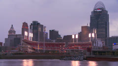 Nighttime falls over Cincinnati as riverboats pass on the Ohio River. Stock Footage