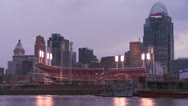 Stock Video Footage of Nighttime falls over Cincinnati as riverboats pass on the Ohio River.