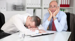 Two despondent tired businessmen - stock footage