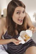 Woman holding box with asian food, portrait Stock Photos
