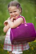 Germany, Bavaria, Girl (4-5) with handbag, portrait, close-up Stock Photos