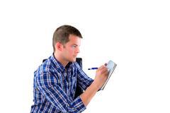 man preparing a list - stock photo