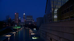 The city of Indianapolis Indiana at night with the White River foreground. Stock Footage