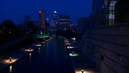 Stock Video Footage of The city of Indianapolis Indiana at night with the White River foreground.