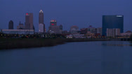 Stock Video Footage of The city of Indianapolis Indiana at dusk with the White River foreground.