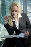 Stock Photo of Business woman with diary, time management, portrait