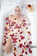 Stock Photo of Woman taking a blossom bath, portrait