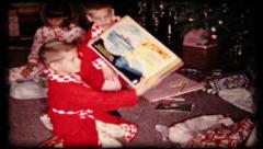 Stock Video Footage of 76 - children get atomic toys for Christmas - vintage film home movie