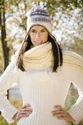 Brunette woman wearing pullover and cap, portrait - stock photo