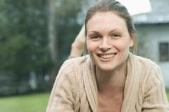 Woman smiling happily Stock Photos