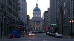 Traffic passes the downtown capital building in Indianapolis, Indiana. - stock footage