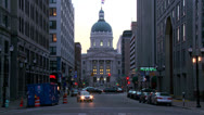 Stock Video Footage of Traffic passes the downtown capital building in Indianapolis, Indiana.