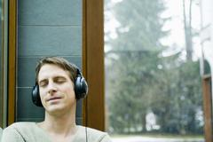 Stock Photo of man with headphones eyes closed