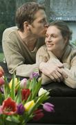 Stock Photo of man kissing woman's forehead