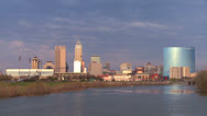 Stock Video Footage of The city of Indianapolis at dusk along the White River.